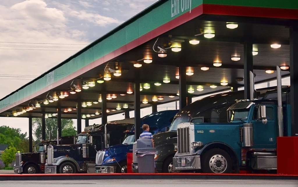 Trucks fueling at truck stop