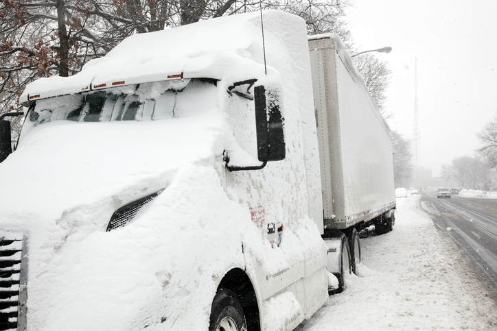 semi truck in winter storm